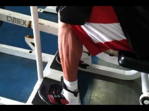 Marc Nadeau trainer performing seated calve