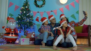 Happy Indian family in Santa hats having fun in clicking selfies during the Christmas holiday