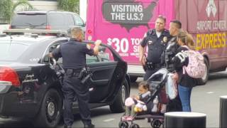 part 1 Lax airport police mom under arrest  for disciplining her kids in public at lax