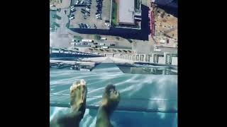 Glass Bottom Pool Over Hangs From Sky Scraper