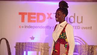 Homecoming, The Identity of an African American in Africa | Ashley Milton | TEDxTudu