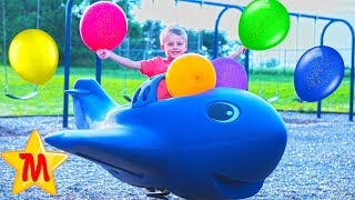 Max Plays With Ballons at a Playground in a Fun Way for Children on Slides