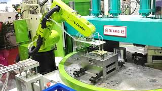 [TAIWANG] China Double head and rotary table injection molding machines with industrial robot
