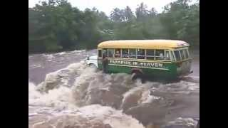 BUS & PASSENGERS WASHED AWAY IN FLOODING RIVER