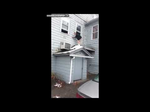 Funny drunk guy falls off roof