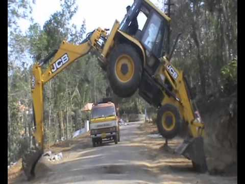 JCB CAN STAND ABOVE A TIPPER by Vishakan  M A Moolayil