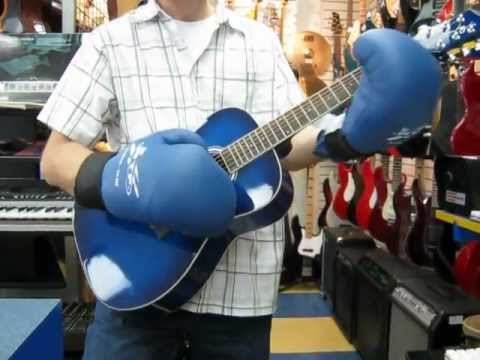 playing guitar with boxing gloves