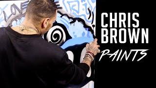 Chris Brown does spray paint art at HOT 97 studios?