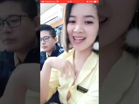 Bigo Live: Beautiful braless shop staff secretly exposing a boob beside her colleague, Vietnam