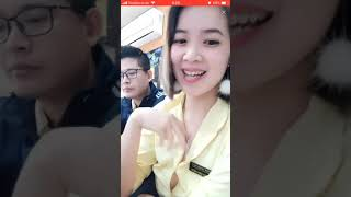 Bigo Live: Beautiful braless shop staff secretly exposing a boob beside her colleague, Vietnam