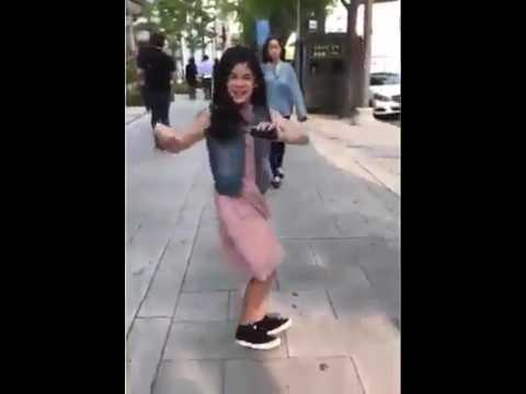 "Asian girl dancing on a song ""Despacito"""