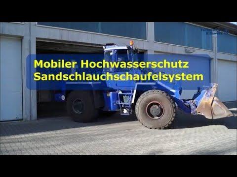 Mobiler Hochwasserschutz des THW München- Ost (Sandschlauch-Schaufelsystem)
