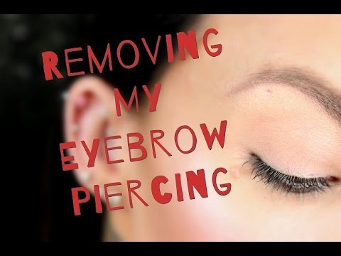 How to take off eyebrow piercing