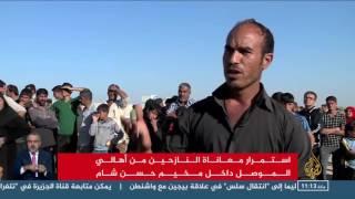 معاناة نازحي الموصل داخل أحد مخيمات الإيواء