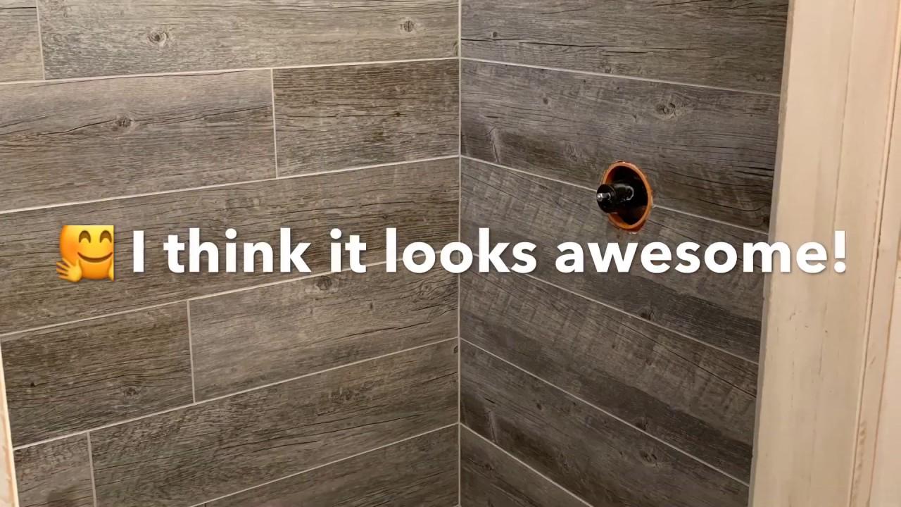 tiny home barnwood stone tile shower diy