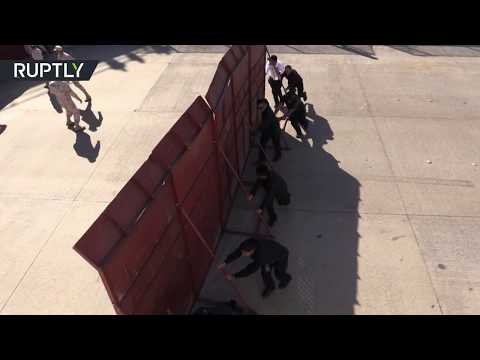 Migrants clash with police as they try to cross US-Mexico border near Tijuana