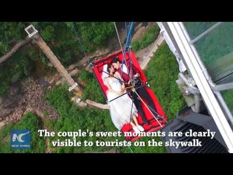 Chinese couple have extreme wedding on glass-bottomed bridge