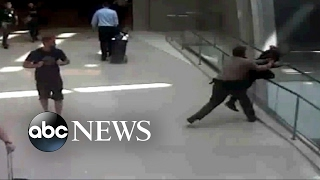 Airport security officer hailed a hero for thwarting man's apparent suicide attempt