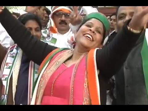 People celebrate with songs and dance before Rahul Gandhi's coronation as Congress Preside