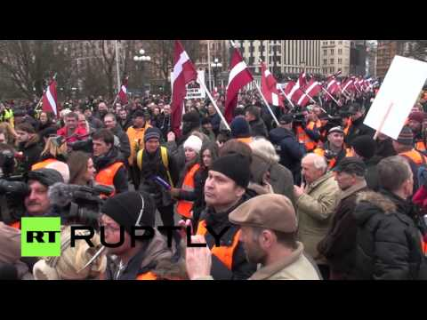RAW: Latvian SS veterans, hundreds of supporters march Legion day
