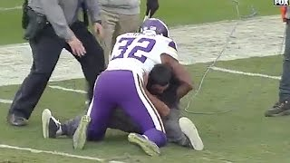 Viking's Safety Antone Exum Tackles Drunk Fan on the Field