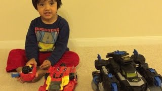 Kid playing with Remote control toys Batman Imaginext Batbot