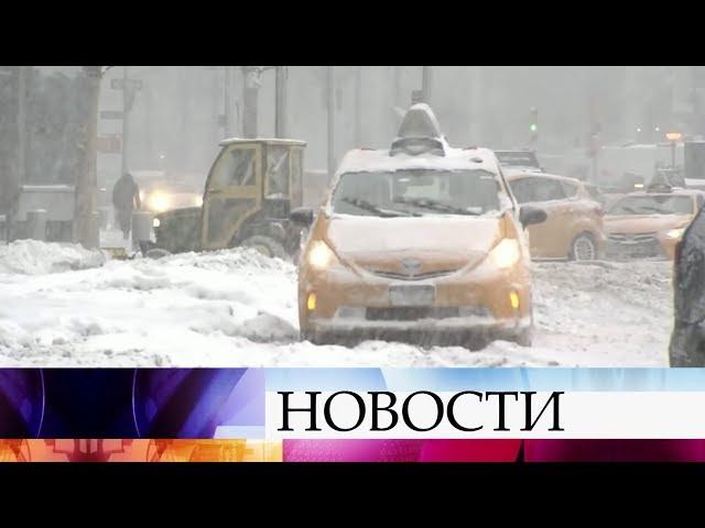 В США из-за снегопада и лютого мороза не работают аэропорты, парализованы дороги, закрыты школы.