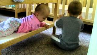 twins playing and talking to each other