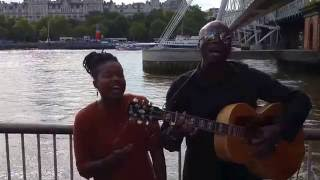 Watch Seal sing Kiss From A Rose in a London street with busker Sherika, 2016