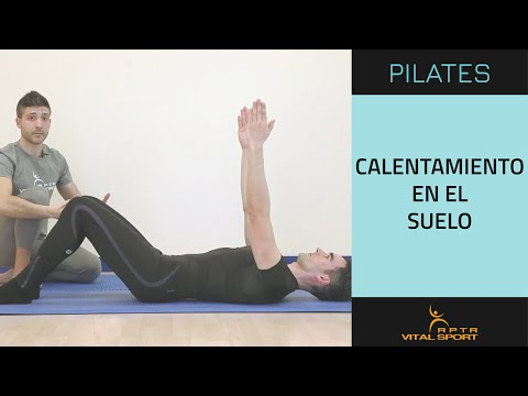 Calentamiento en el suelo en Pilates