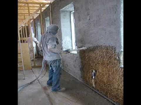 Spraying Lime Base On Straw Bale House Youtube
