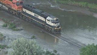 Watch train negotiate flooded track in NE Colorado thumbnail