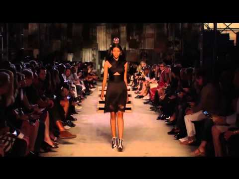 Models Candice Swanepoel & Pooja Mor fall down during Givenchy Spring/Summer 2016 fashion show