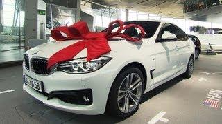 Der 100.000ste BMW Abholer -- ein großer Tag für Helmut Marxen und BMW.