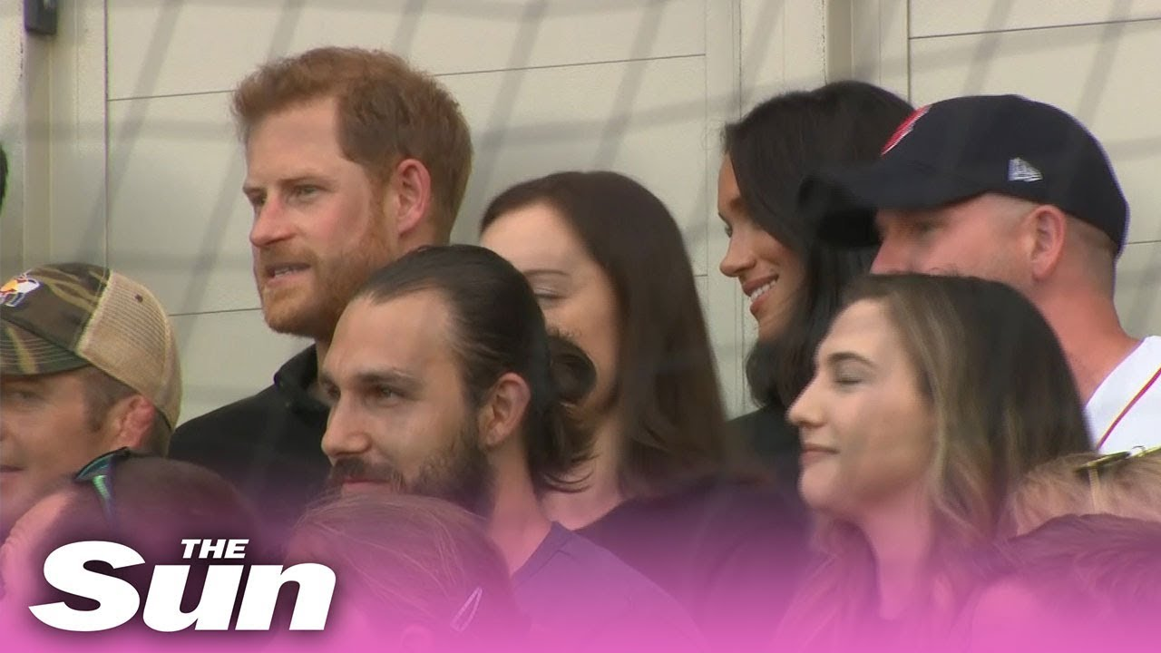 Awkward moment Prince Harry 'ignores' Meghan Markle as she tries to talk to him at baseball game