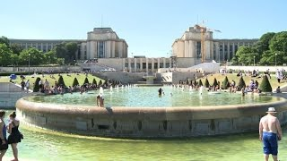 Tourists try to cool off as temperatures soar in Paris