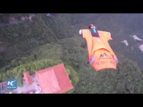 Daredevil's sport: Wingsuit flying world cup in C China