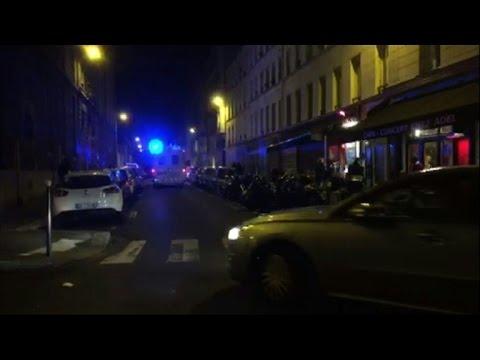 Police: Multiple attacks in Paris, dozens dead