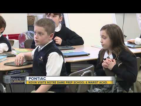 Kevin visits students at Notre Dame Preparatory School and Marist Academy in Pontiac
