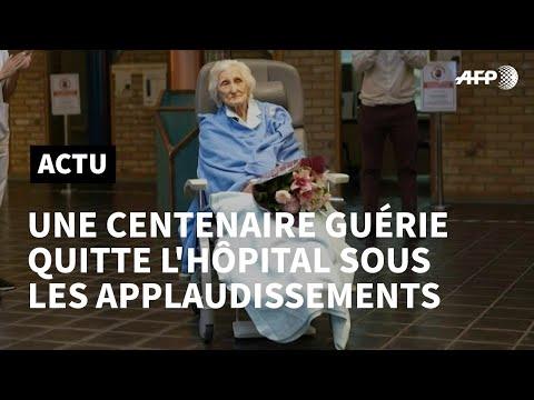 Coronavirus: en Belgique: une centenaire guérie quitte l'hôpital sous les applaudissements | AFP