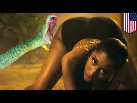 Attaque d'anaconda: Une danseuse de Nicky Minaj se fait attaquer par un serpent constricteur.de YouTube · Durée:  39 secondes