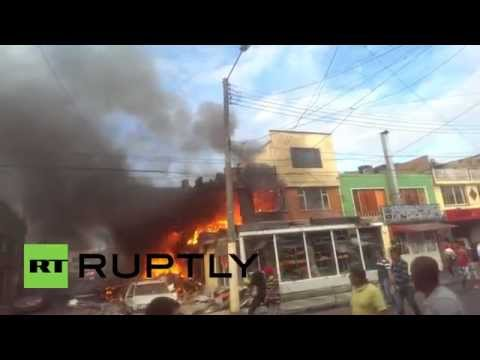 Colombia: Firefighters extinguish blaze after plane crashes into Bogota bakery