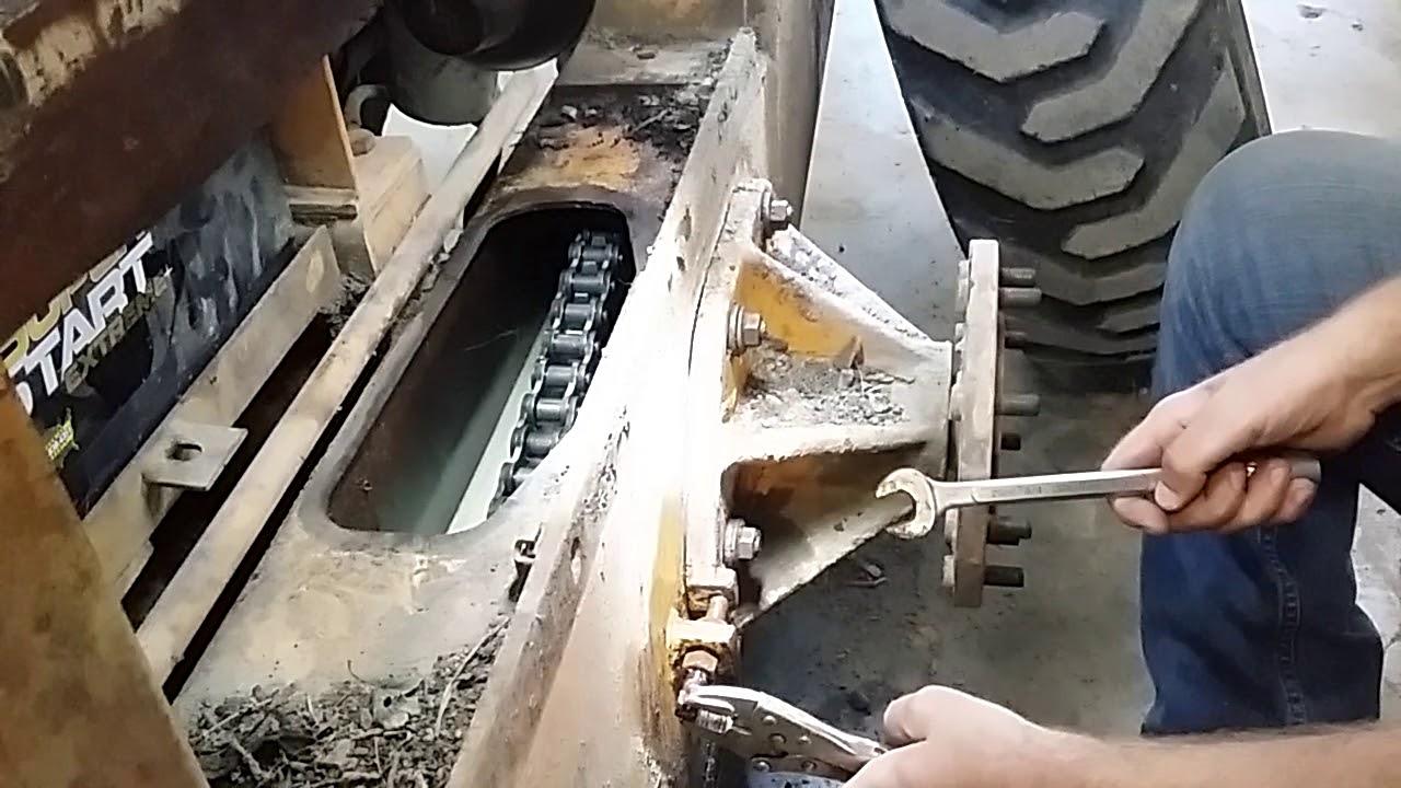 Case 1845 drive chain adjustment - YouTube