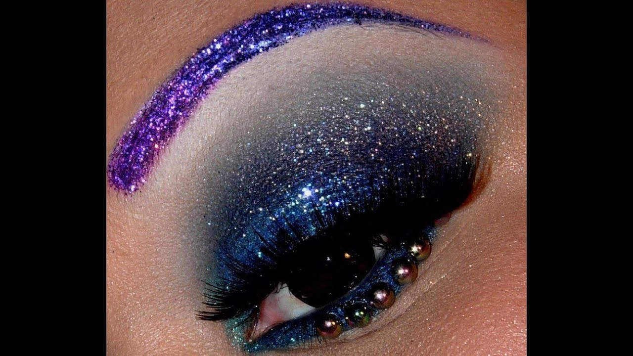 purple glitter eyebrows and glittery smokey blue eyes