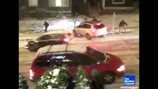 Vehicles slide down icy hill AC09.flv