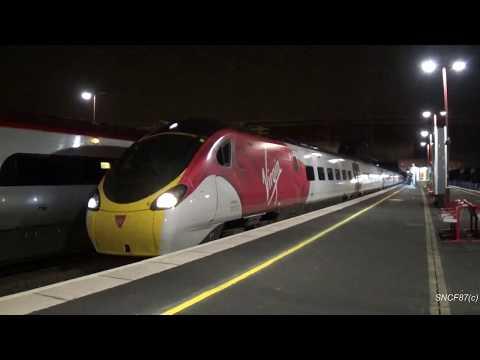 New Livery Virgin Trains Class 390 departs at Birmingham International