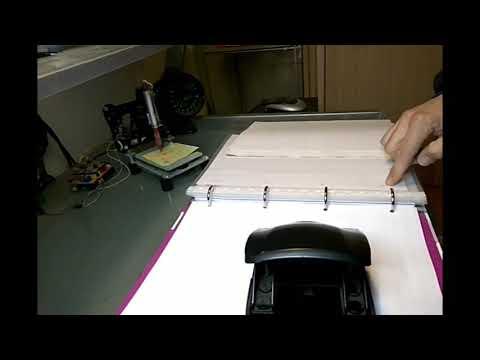 Perforar folios 4 orificios en A4 con perforadora de dos.
