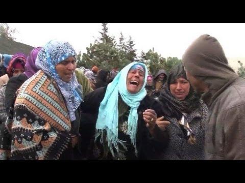 Tunisia street vendor's funeral becomes anti-Islamist demo