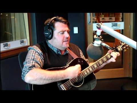 Alex Lloyd performs in the 3AW studio with Denis Walter