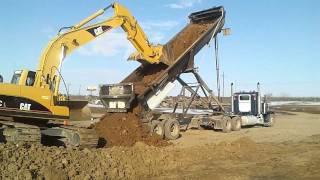 end dump unloading dirt